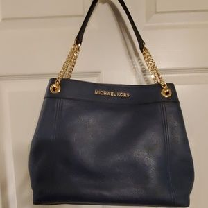 Michael Kors Jet Set bag with gold chain accents